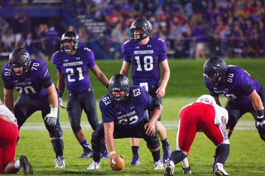 Freshman quarterback Clayton Thorson reads the defense as he readies to snap the ball. The Cats quarterback has been praised for his poise and ability to communicate with teammates pre-snap.
