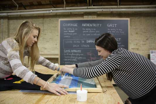 Michelle Kokes (left) and Alayna Rickard (right) create their own T-shirt during a session prior to the official opening of Hackstudio. The new Evanston business, which opened Monday, helps students in third through 12th grade pursue any creative project of their choosing.