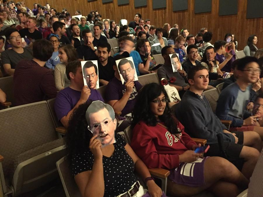 Students show off their Stephen Colbert masks at a livestreaming event of his debut as the host of