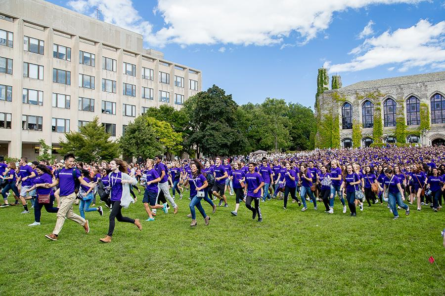 New Wildcats dash across Deering Meadow this Wildcat Welcome prior to taking their class photo. Among the incoming students, the proportion of international students hit a record high this year.