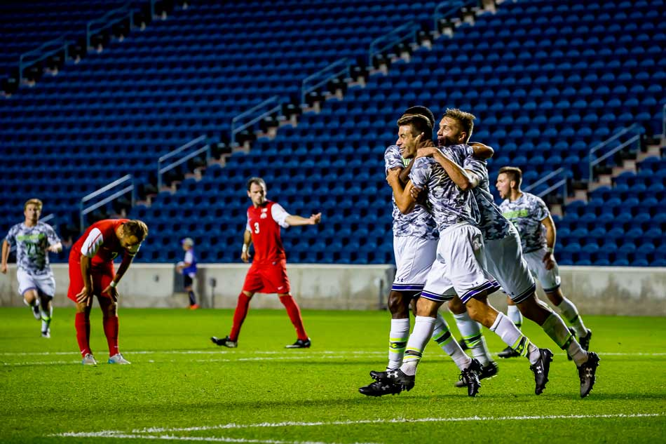 A pack of Wildcats celebrate a goal. Northwestern needed late game heroics from sophomore forwards Sam Forsgren and Elo Ozumba to escape UIC with a 2-1 double overtime victory on Wednesday.