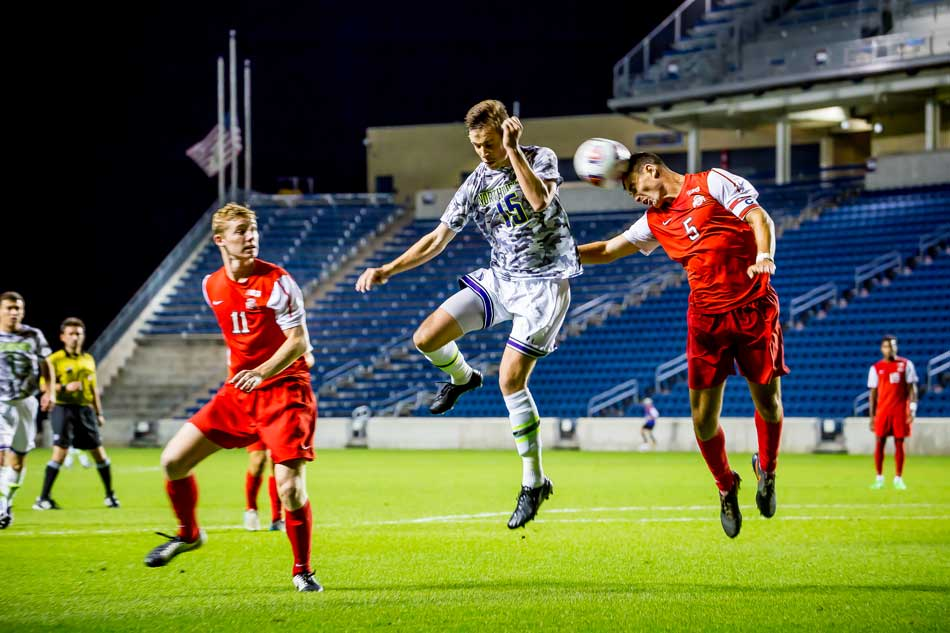 Senior midfielder Cole Missimo leaps for a header. The Wildcats were unable to finish near the goal as they were shutout at home against Indiana.