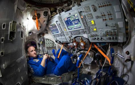 Astronaut Scott Kelly lounges inside a Soyuz simulator. Kelly went into space in March and will become the first American to stay at the International Space Station for more than 215 days.