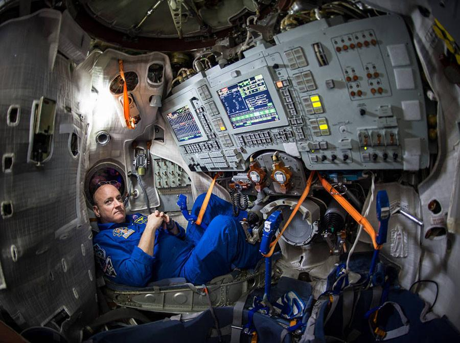 Astronaut+Scott+Kelly+lounges+inside+a+Soyuz+simulator.+Kelly+went+into+space+in+March+and+will+become+the+first+American+to+stay+at+the+International+Space+Station+for+more+than+215+days.