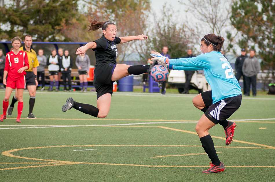 Sophomore midfielder Kim Jernatowski leaps in the air to get a foot on the ball. The Wildcats start a home stand against conference opponents on Thursday when they host Maryland at Toyota Park.