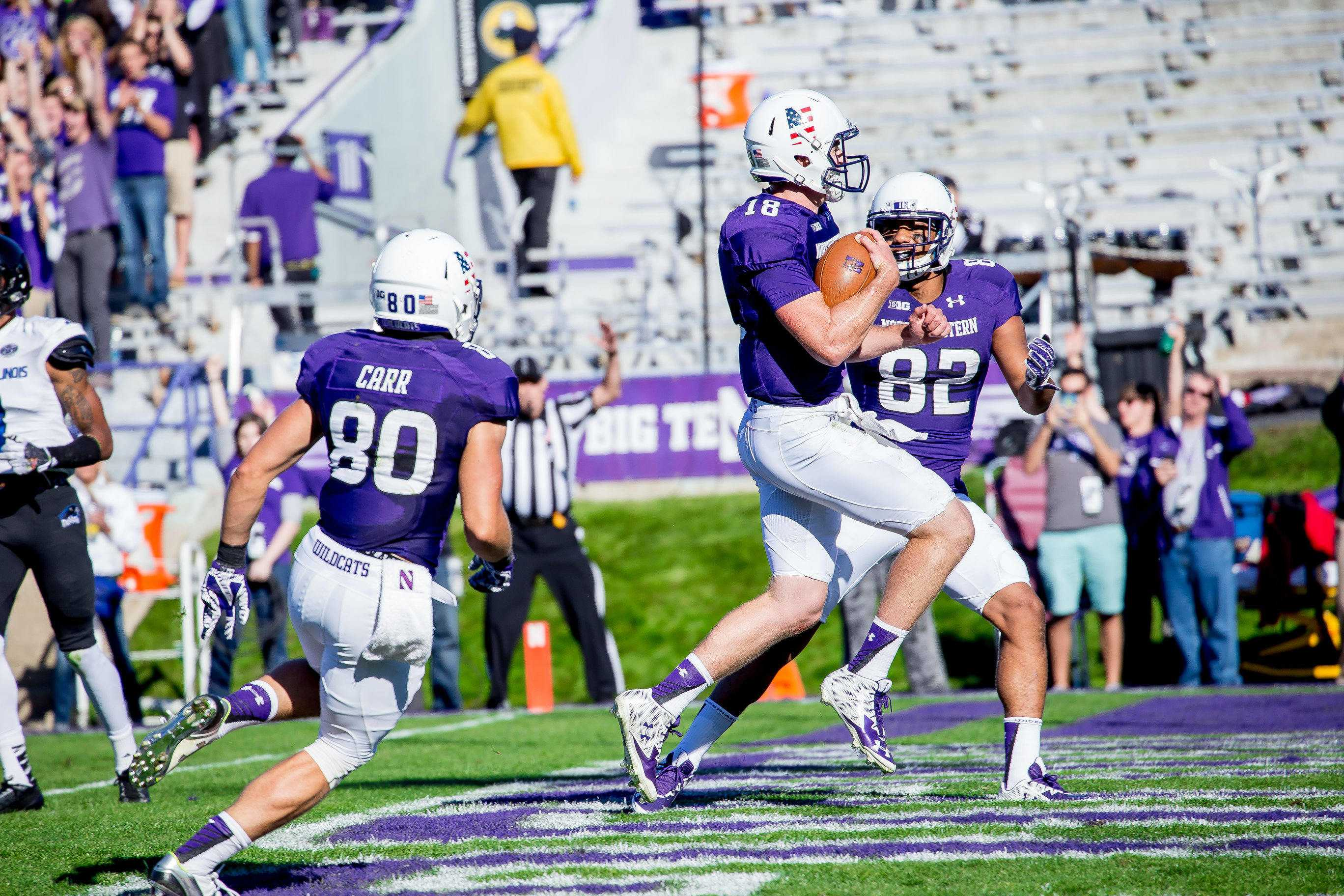 Redshirt freshman quarterback Clayton Thorson celebrates in the end zone following his second rushing touchdown of the season. Thorson also threw for a score in Northwestern's 41-0 win.