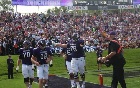 Redshirt freshman quarterback Clayton Thorson celebrates with teammates following his second-quarter touchdown. Northwestern topped No. Stanford 16-6 on Saturday.