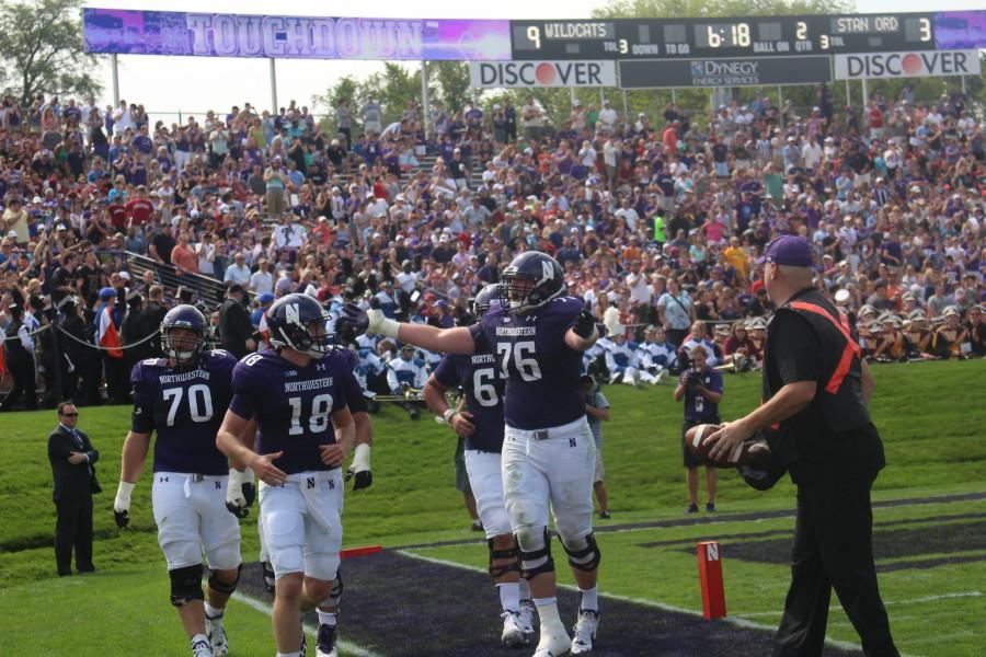 Redshirt+freshman+quarterback+Clayton+Thorson+celebrates+with+teammates+following+his+second-quarter+touchdown.+Northwestern+topped+No.+Stanford+16-6+on+Saturday.