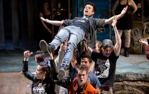 "Charlie Oh, who is hoisted up, and the cast rehearse for ""American Idiot."" The show opens on Oct. 16 at the Ethel M. Barber Theater."