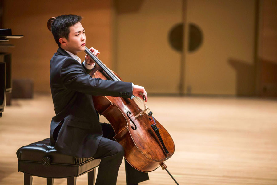 Brannon Cho plays his cello on stage during Minnesota Orchestra Young Artists Competition finals earlier this May. This month, the Bienen junior took second place in the Naumburg International Cello Competition.
