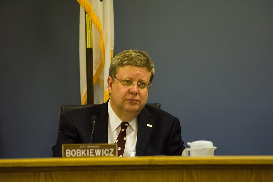City manager Wally Bobkiewicz attends a City Council meeting. He told aldermen at a special City Council meeting Saturday that Evanston needs to prepare for likely state funding cuts and a potential property tax freeze across Illinois.