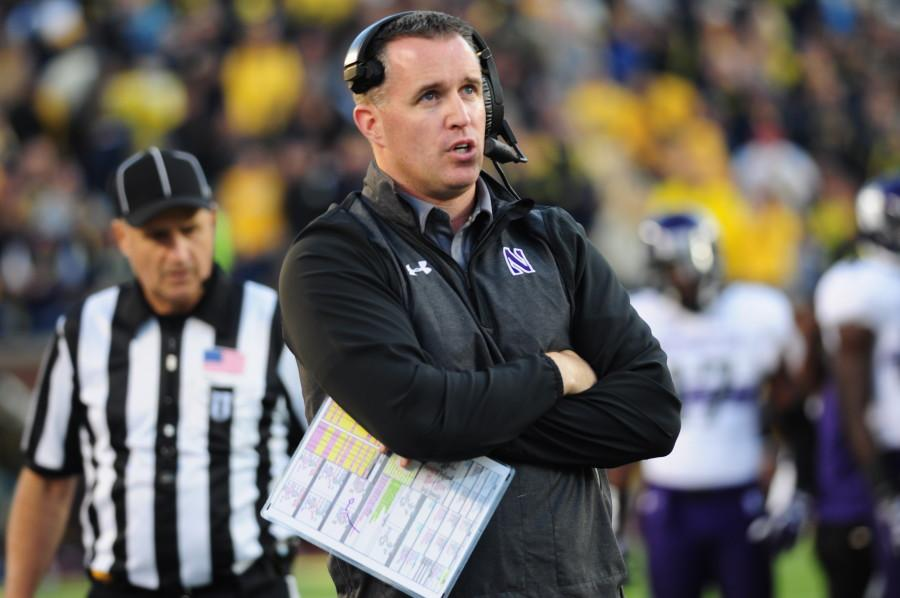 """Coach Pat Fitzgerald stares onto the field during Saturdays loss to Michigan. """"We got beat by a very good team today, and we didn't play well, and we made them look better,"""" Fitzgerald said."""