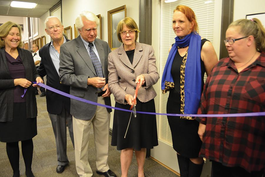 Evanston Mayor Elizabeth Tisdahl cuts the ribbon dedicating the Civic Center's aldermanic library to former mayor Joan Barr-Smith. Barr-Smith, the city's first female mayor, passed away last spring.