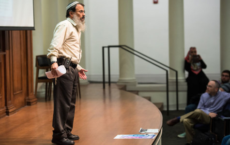 """Rabbi Hanan Schlesinger discussed how the path forward in the Israeli-Palestinian conflict is a nonviolent national """"revolution."""" Schlesinger and Ali Abu Awwad hope to educate Israelis and Palestinians through Roots, a peace movement."""