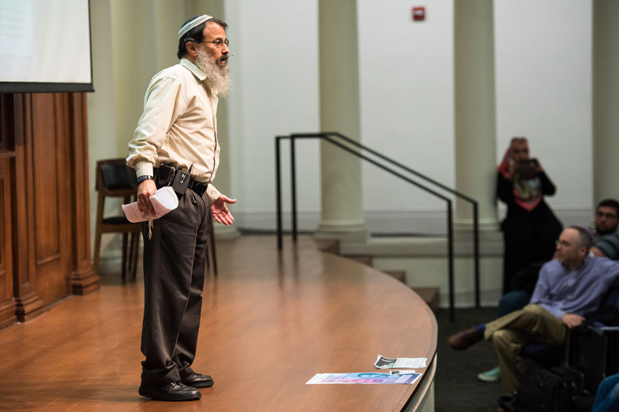 "Rabbi Hanan Schlesinger discussed how the path forward in the Israeli-Palestinian conflict is a nonviolent national ""revolution."" Schlesinger and Ali Abu Awwad hope to educate Israelis and Palestinians through Roots, a peace movement."