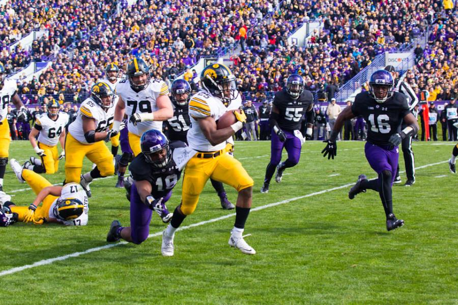 Iowa running back Akrum Wadley sprints away from the NU defense. With Nebraska up next, the Cats are trying to fix the little mistakes that contributed to their two consecutive defeats.