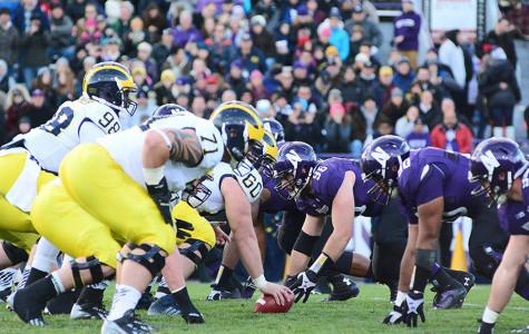 Michigan's offensive line faces off against Northwestern's defensive line in last year's game. Both sides this week emphasized the importance of dominating the trenches.