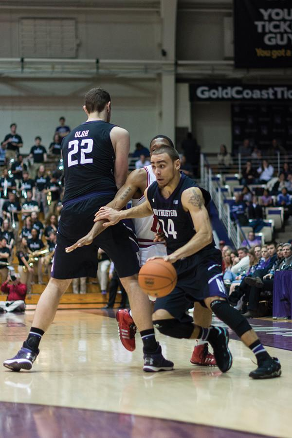 Senior guard Tre Demps and senior center Alex Olah run the pick-and-roll. The two seniors will be counted on as leaders for a young NU team this season.