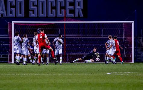 Zak Allen saves a free kick. The senior goalkeeper has been successful on the field as of late, and his work in goal is part of the reason the Cats are right back in the conversation to make the NCAA Tournament.