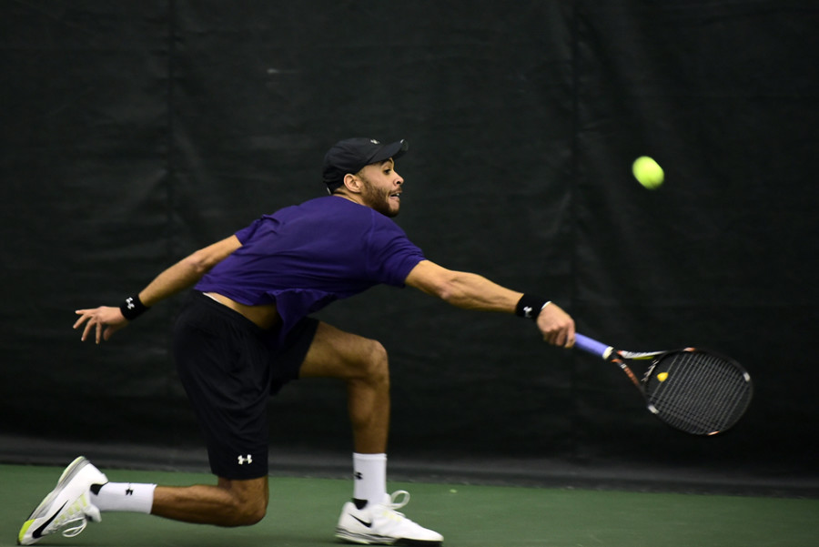 Sam Shropshire lunges to return a ball. The junior didn't play his best at the ITA Midwest Regional Championships and was bounced in the second round.