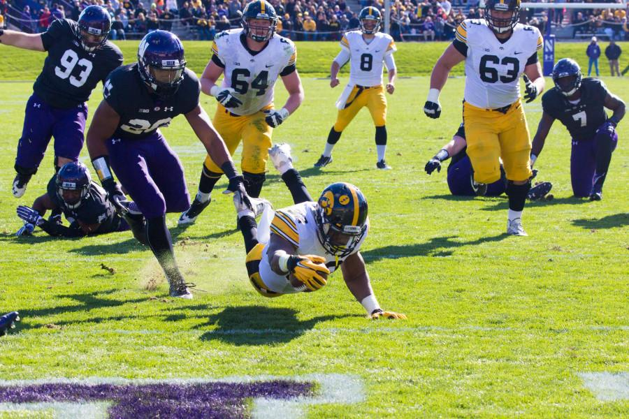 Iowa+running+back+Derrick+Mitchell+Jr.+dives+into+the+end+zone+for+a+touchdown.+The+Hawkeyes+gashed+the+Wildcats+on+the+ground%2C+rushing+for+294+yards.