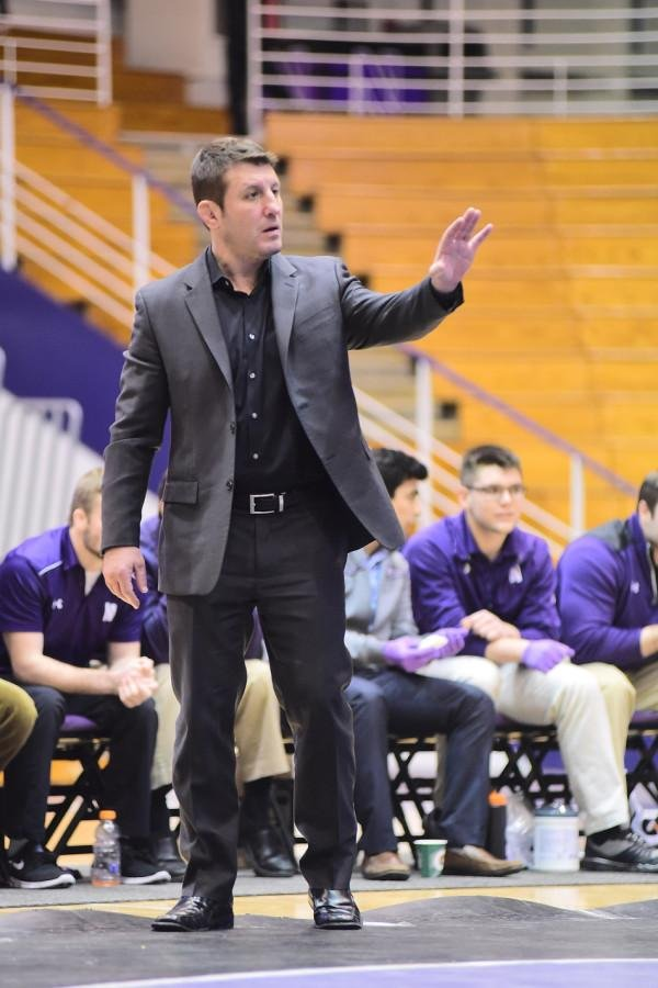 Drew Pariano gestures during a wrestling match. Northwestern announced Monday night that Pariano will no longer coach the team.