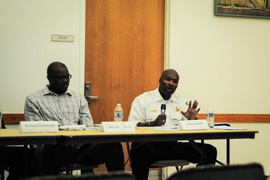 Evanston+Police+deputy+chief+James+Pickett+discusses+EPD+regulations+regarding+civilian-police+interactions+Wednesday+night.+More+than+60+people+attended+the+event+held+at+the+Levy+Senior+Center.+
