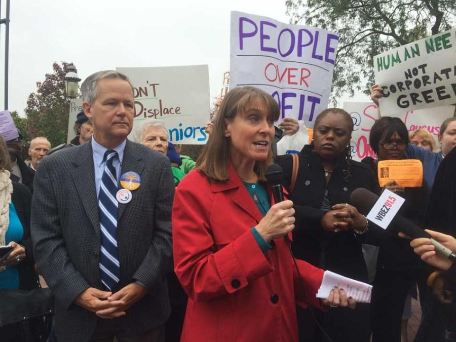 State Rep. Laura Fine (D-Glenview) speaks alongside Ald. James Cappleman of Chicago's 46th ward at a demonstration Monday morning against the closure of affordable housing in north Chicago for senior citizens. More than 60 people protested outside the Evanston headquarters of Presbyterian Homes.