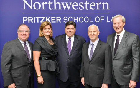 School of Law Dean Daniel Rodriguez, M.K. Pritzker, J.B. Pritzker, University President Morton Schapiro and Board of Trustees chairman William Osborn attend the announcement of the Pritzker family's $100 million donation to the School of Law. The school was renamed the Pritzker School of Law in honor of the Pritzkers' gift.