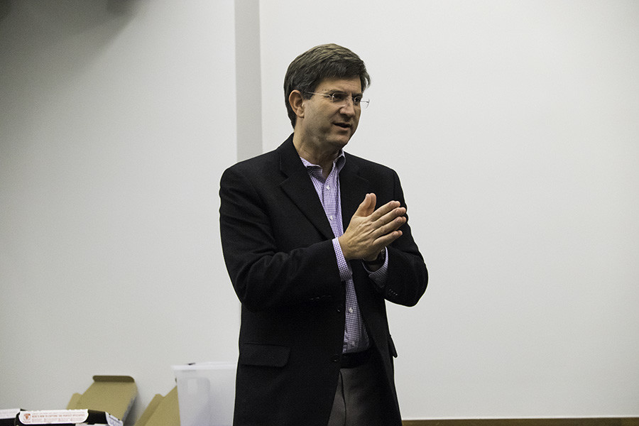 Former Rep. Brad Schneider addresses a room of Northwestern students Tuesday night. The ex-Congressman discussed his tenure as a representative and his intentions to run again in 2016.