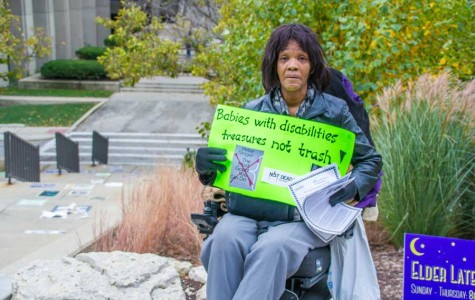 Shelley Barry protests outside a talk by Princeton Prof. Peter Singer, who in the past has advocated for euthanizing disabled babies. Singer arrived at NU on Saturday as a speaker for the Chicago Humanities Festival and was met by a group of protesters outside Norris University Center.