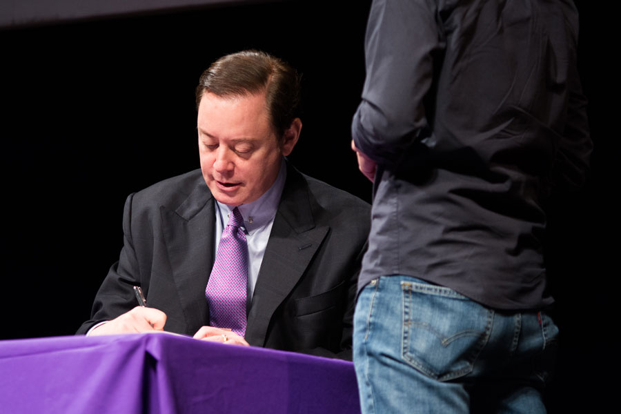 "Author Andrew Solomon signs copies of his book ""Far from the Tree: Parents, Children, and the Search for Identity"" for audience members following a talk in Cahn Auditorium. Solomon, a bestselling author, spoke about issues of identity in families of children with disabilities."