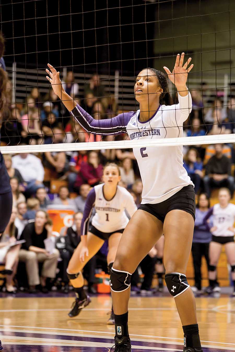 Symone Abbott waits for the ball to be served. The sophomore outside hitter totaled 19 kills this weekend for the Cats but was unable to help lift NU to a victory in either contest.
