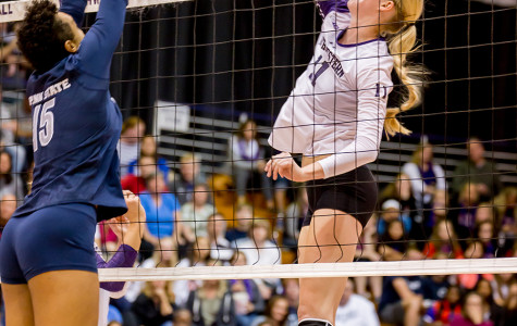 Junior middle blocker Maddie Slater spikes the ball. Slater notched 12 kills for the Cats over the weekend, including eight in the team's victory over Iowa on Sunday.