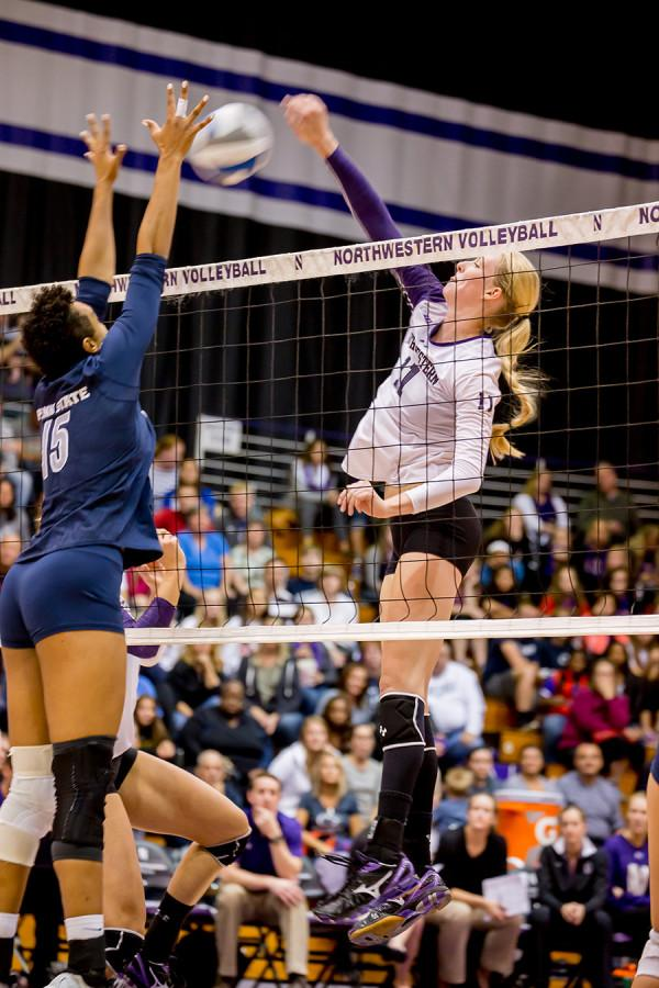 Junior+middle+blocker+Maddie+Slater+spikes+the+ball.+Slater+notched+12+kills+for+the+Cats+over+the+weekend%2C+including+eight+in+the+team%E2%80%99s+victory+over+Iowa+on+Sunday.