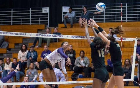 Sophomore outside hitter Symone Abbott hits the ball through the block. Abbott posted a team-high 10 kills in the Cats' loss in Madison against No. 19 Wisconsin.