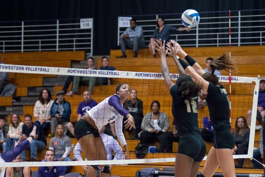 Sophomore+outside+hitter+Symone+Abbott+hits+the+ball+through+the+block.+Abbott+posted+a+team-high+10+kills+in+the+Cats%E2%80%99+loss+in+Madison+against+No.+19+Wisconsin.