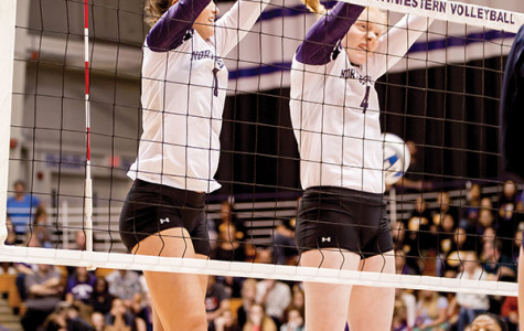 Sophomore setter Taylor Tashima and freshman middle blocker Rachael Fara leap to block a return. NU is coming off of a victory against Penn State but now has to welcome Nebraska to Evanston for the Cats' fifth-straight contest against a ranked opponent.