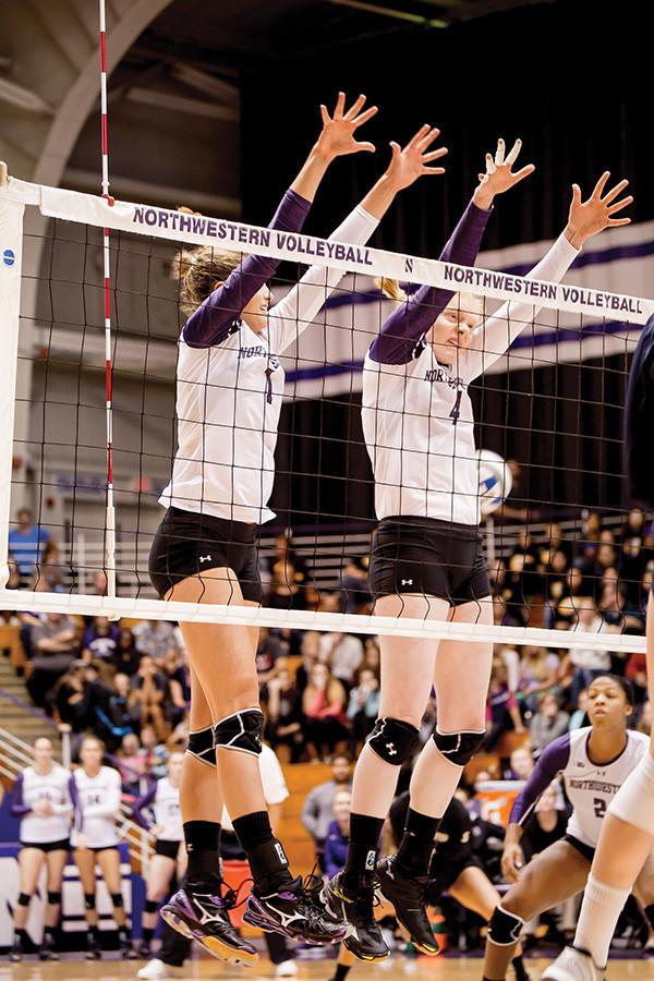 Sophomore+setter+Taylor+Tashima+and+freshman+middle+blocker+Rachael+Fara+leap+to+block+a+return.+NU+is+coming+off+of+a+victory+against+Penn+State+but+now+has+to+welcome+Nebraska+to+Evanston+for+the+Cats%E2%80%99+fifth-straight+contest+against+a+ranked+opponent.