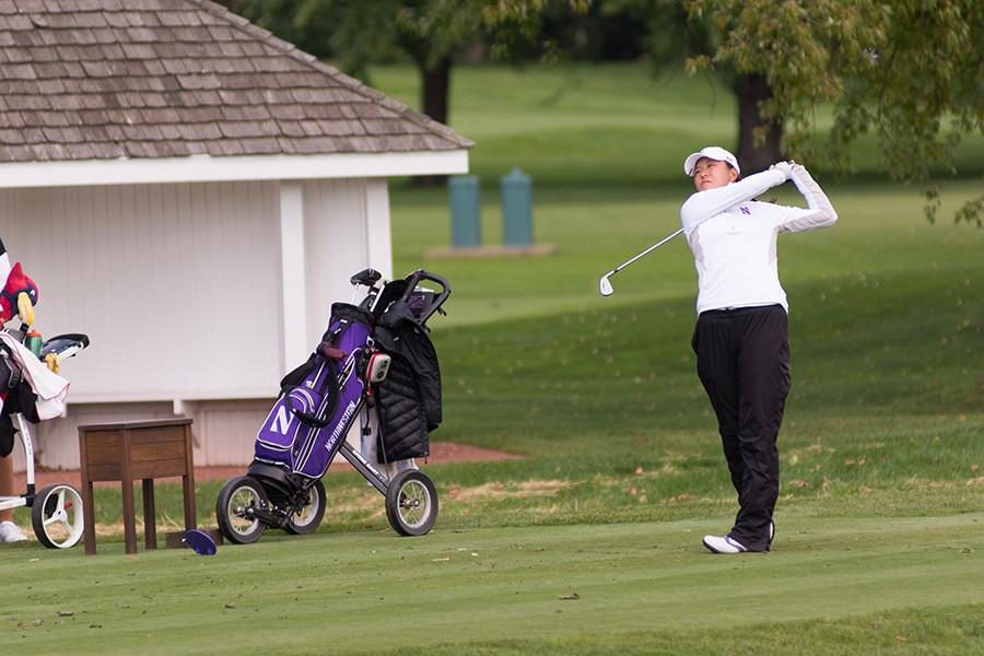 Sophomore Hannah Kim follows through on a swing. Kim, the reigning Big Ten Player of the Year, has contributed to the Cats' depth this season, which has been one of the primary reasons they have finished top-two in all three of their tournaments this year.