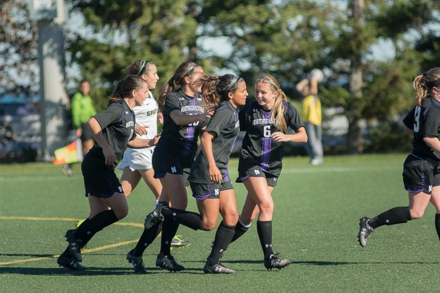 Sophomore defender Kassidy Gorman (far right) shares a laugh with senior Nandi Mehta. Gorman and Mehta are two of four defenders NU has used this season to become a formidable defensive unit.