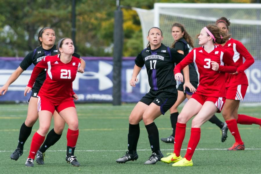 Junior midfielder Maria Grygleski and sophomore midfielder Kim Jerantowski search for the ball in the air. NU was unable to capitalize on balls in the air, and that was part of its demise against Nebraska.