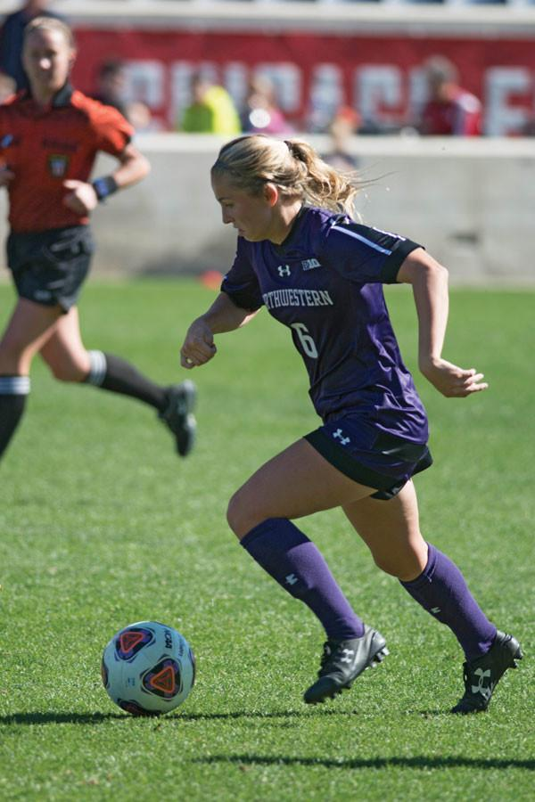 Kassidy Gorman dribbles around a defender earlier this season. The sophomore defender scored the winning goal in double overtime against Wisconsin Wednesday.