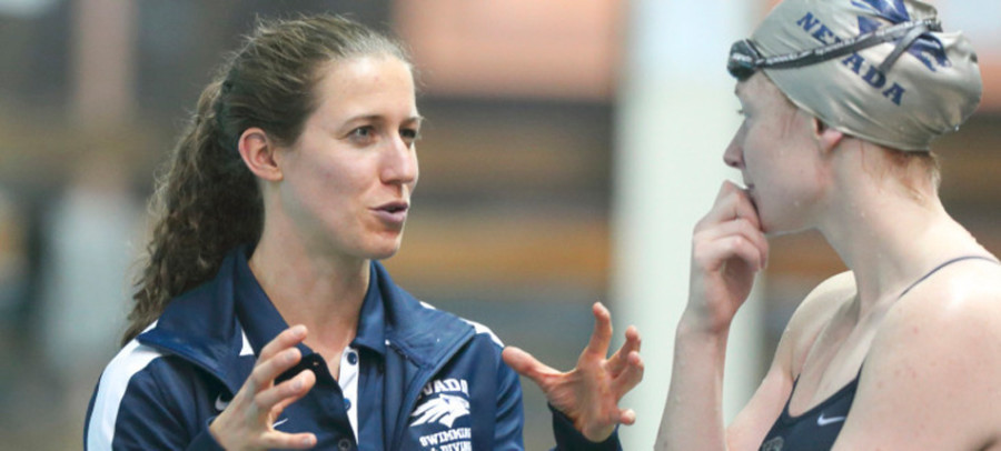 """Coach Abby Steketee talks with a swimmer at Nevada. Steketee, an NU grad, is returning to Evanston to start her """"dream job"""" as the Cats leader this season."""