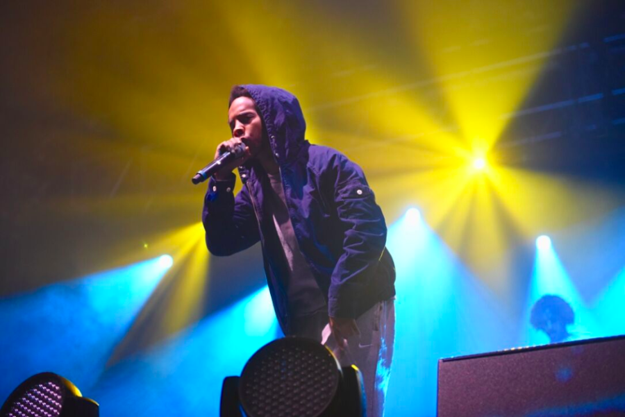 Earl Sweatshirt leans over the stage at Aragon Ballroom to a crowd of Northwestern students during his performance Friday. The rapper's set preceded Icona Pop's performance at A&O Production's annual Blowout concert.