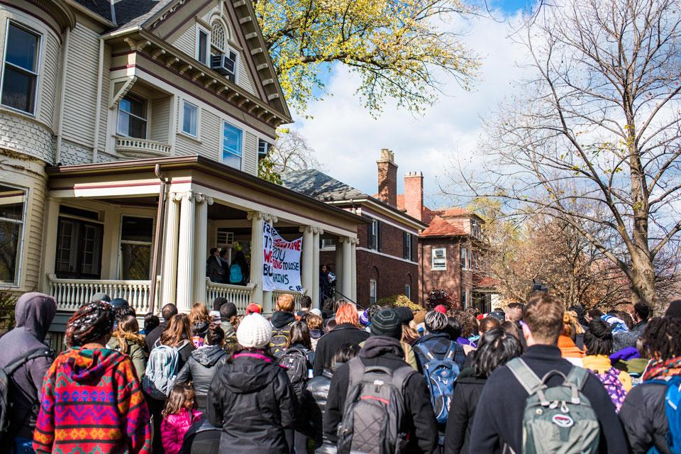 Students gather outside the Black House on Nov. 13 to protest institutional racism at Northwestern and other universities. Students released an official list of demands to the University on Friday to enhance the experiences of students of color at NU.
