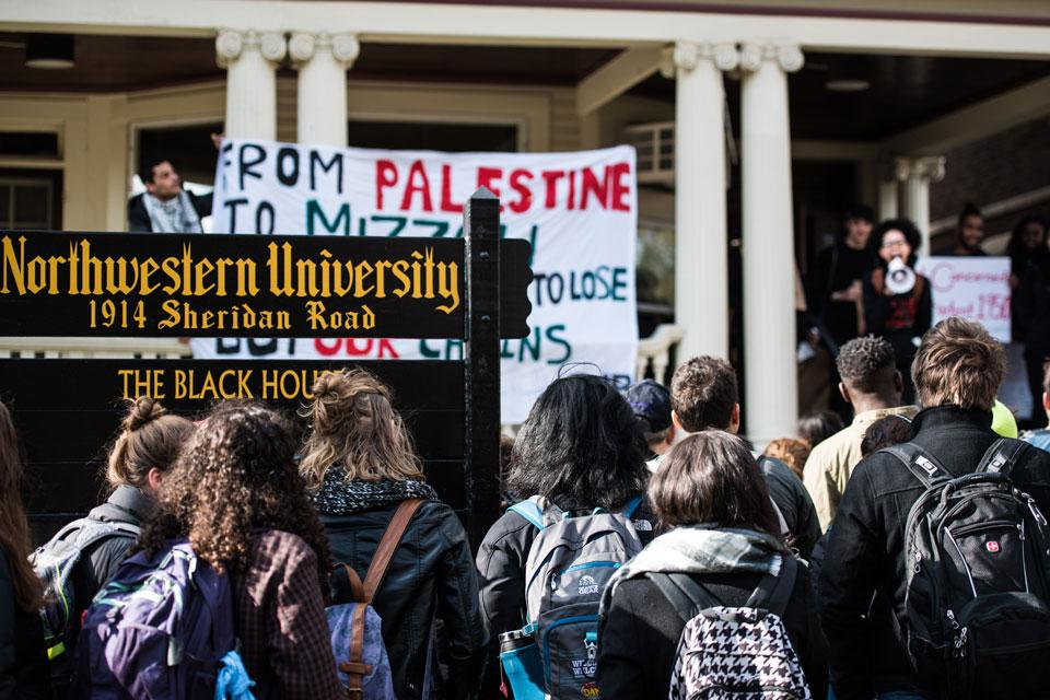 Students gather outside the Black House on Friday to protest institutional racism at Northwestern and other universities. The protesters later moved to Henry Crown Sports Pavilion, where they spoke out at a groundbreaking ceremony for a new athletic facility.