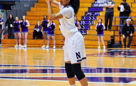 Nia Coffey lines up a three-point shot. The junior forward led the Wildcats with 12 double-doubles last season and owns 20 over her career.