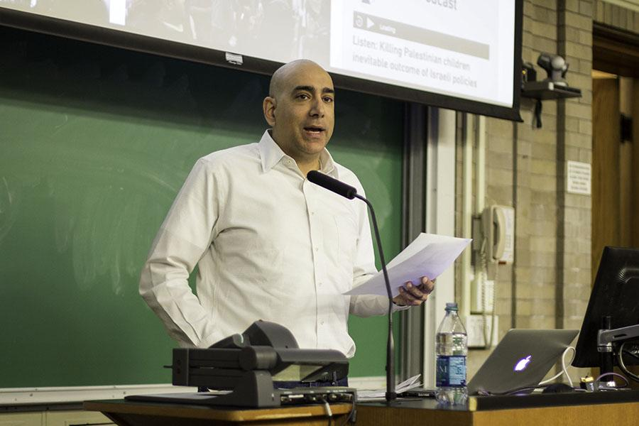 Pro-Palestinian activist Ali Abunimah presents a speech on Israeli-Palestine tensions in a classroom at Swift Hall. Abunimah, who made headlines when his talk at Evanston Public Library was canceled and reinstated two summers ago, returned to Northwestern's campus on Thursday for a Students for Justice in Palestine event.