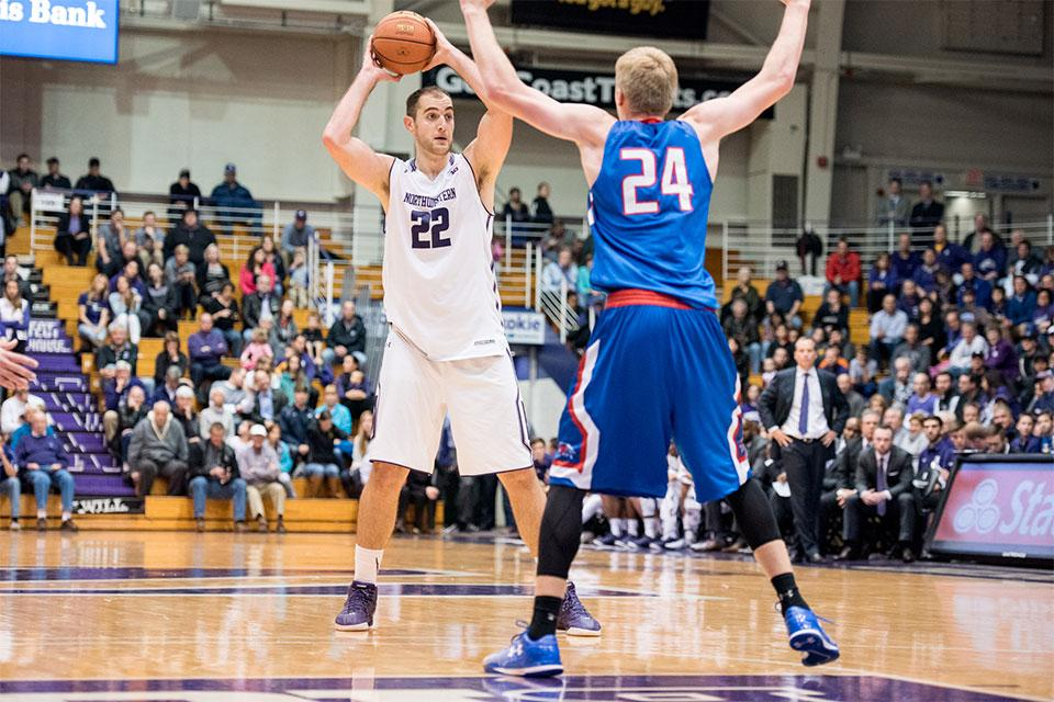 Alex Olah looks for an open man at the top of the key. The senior center started strong in Monday's game, but as the contest wore on, the more athletic front court of North Carolina took advantage of him and combined for 53 points and 30 rebounds on the night.